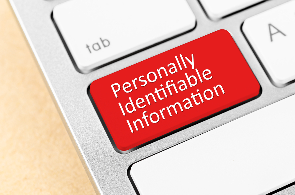 Personally Identifiable Information on a button on a keyboard