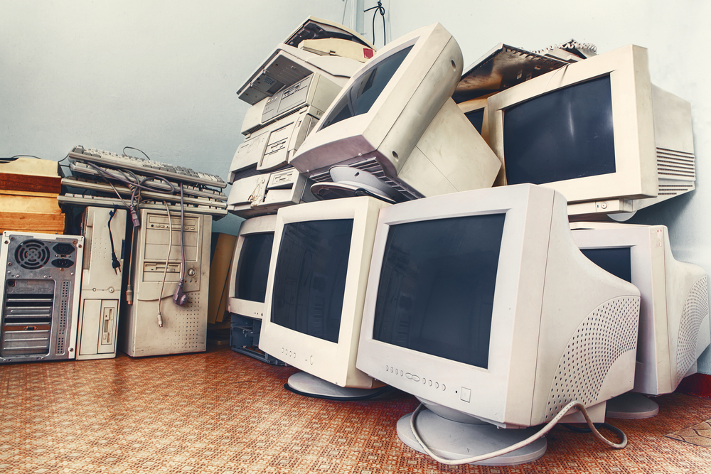 Pile of old used computers and monitors