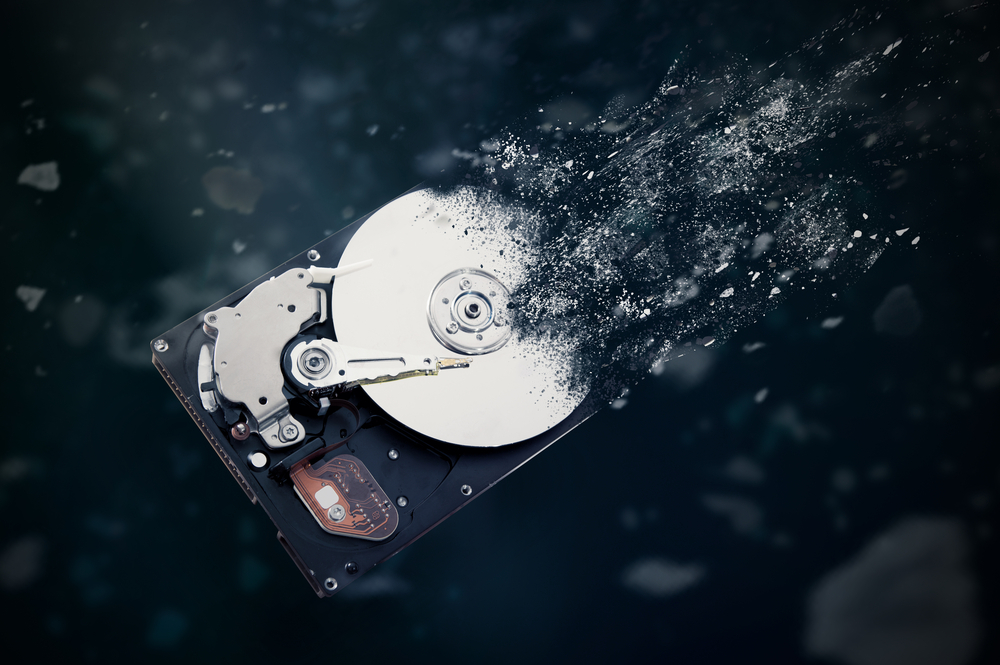 Old hard drive disintegrating into space concept